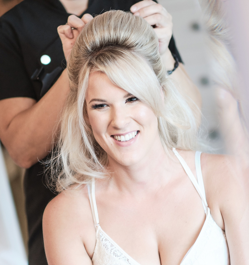 Glamour Brides hair and makeup artists in Kent creating a half-up-half-down wedding hair look for their bride