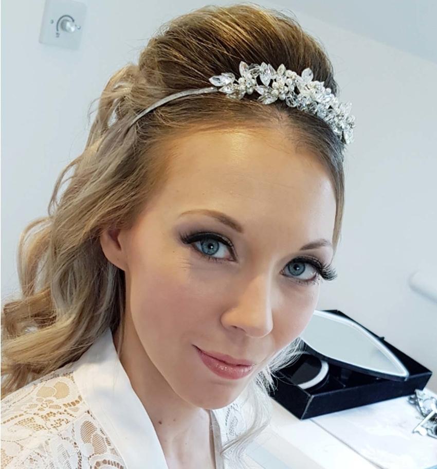 Bride with tiara-adorned hair and fake eyelashes