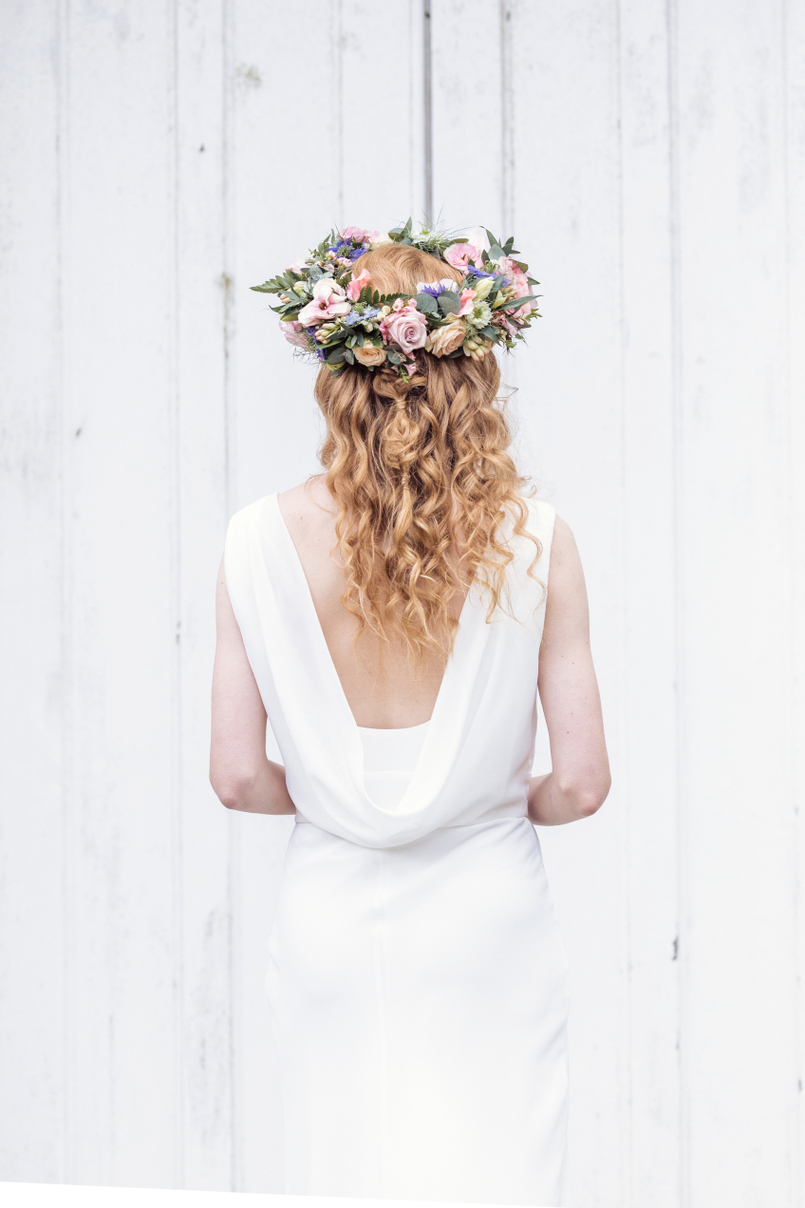 Curly, long wedding hair complete with a flower crown by one of the best wedding hair and makeup artists in Kent, Kirsten from Kirsten hair and makeup