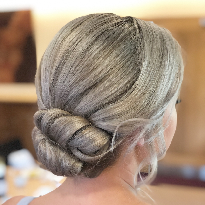 Ashy blonde hair in a pristine low bun