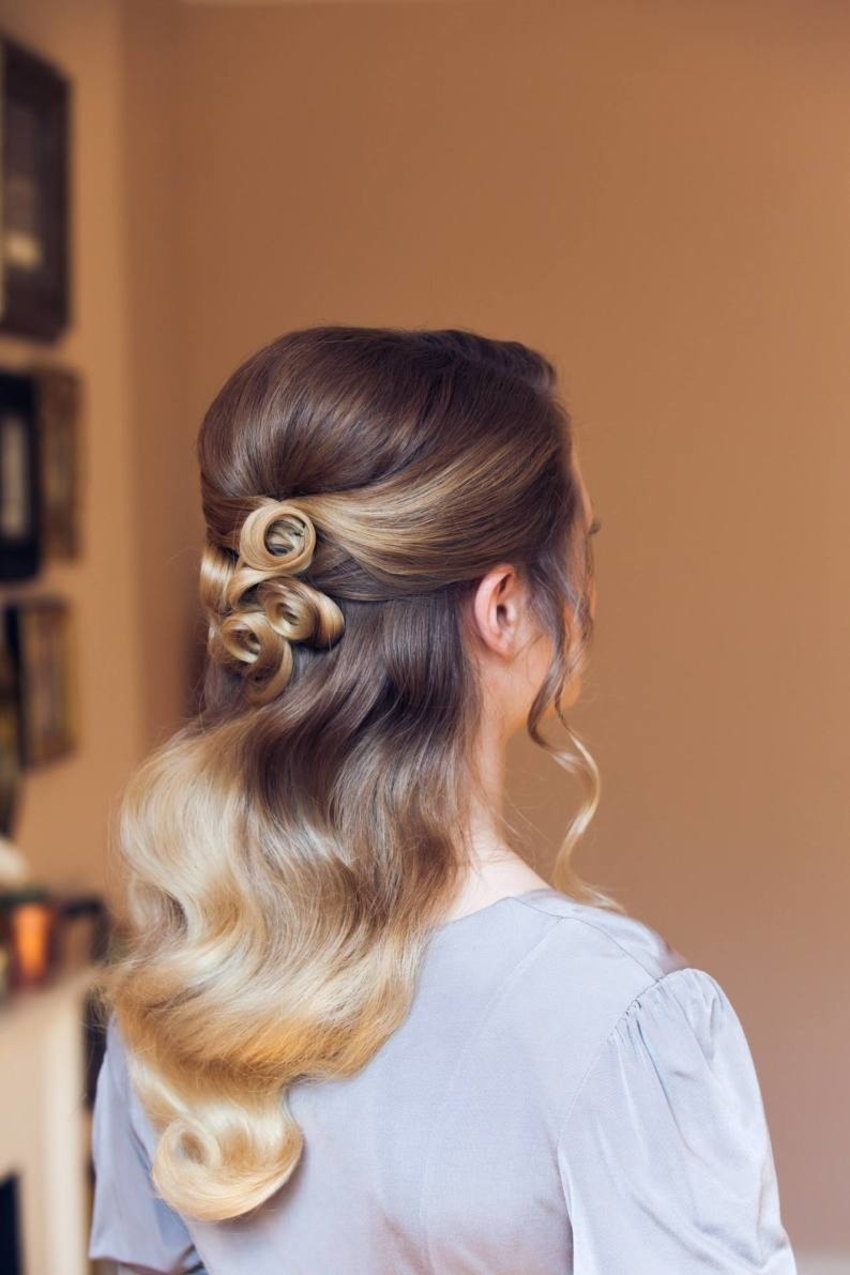 Unique wedding hairstyle complete with tight curls pinned to the back of by one of the best wedding hair and makeup artists in Kent