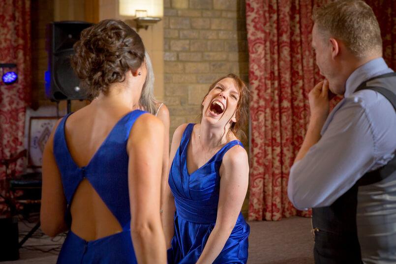 Bridesmaids laughing at Chilham Bridal bride wedding