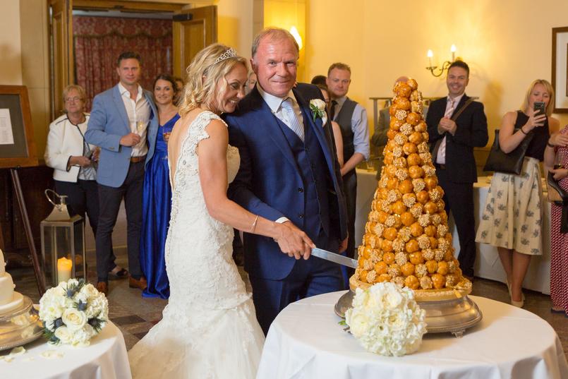 Carine and Steve cutting French wedding cake