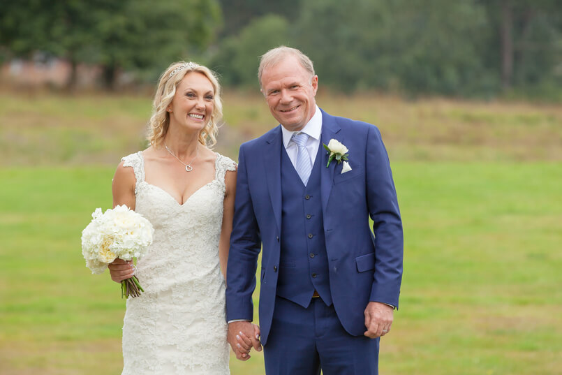 Carine smiling and looking at the camera wearing her Chilham Bridal wedding dress