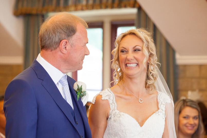 Happy bride at her wedding ceremony in UK