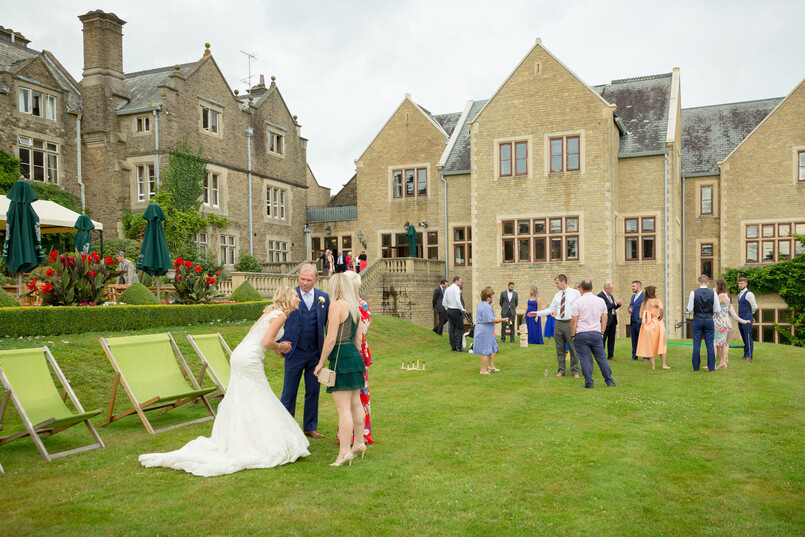 Bride and groom talking to their guests on the lawn