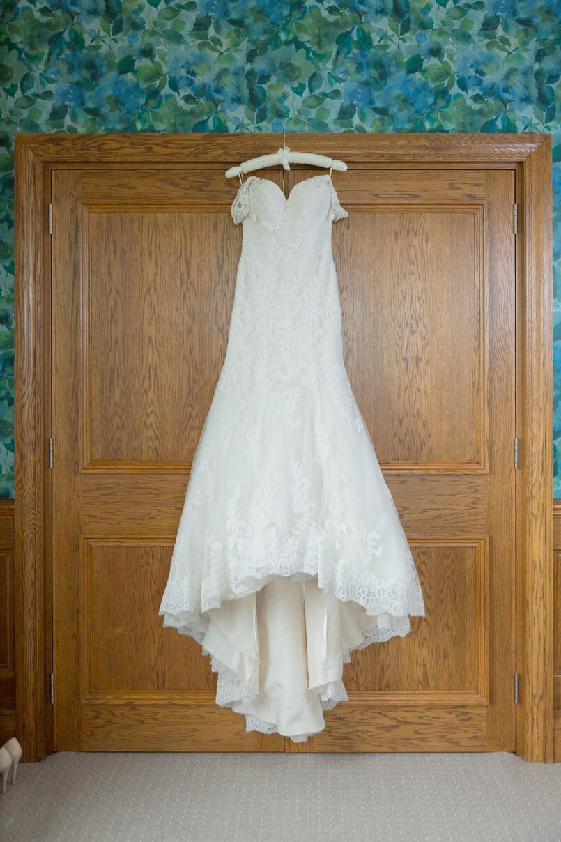Justin Alexander wedding dress hanging up on bride's wedding day