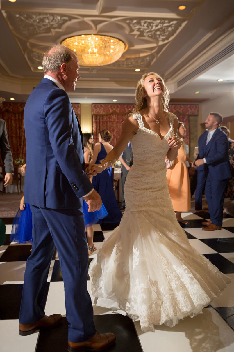 Carine and Steve dancing on a chequered dance floor at South Lodge Hotel