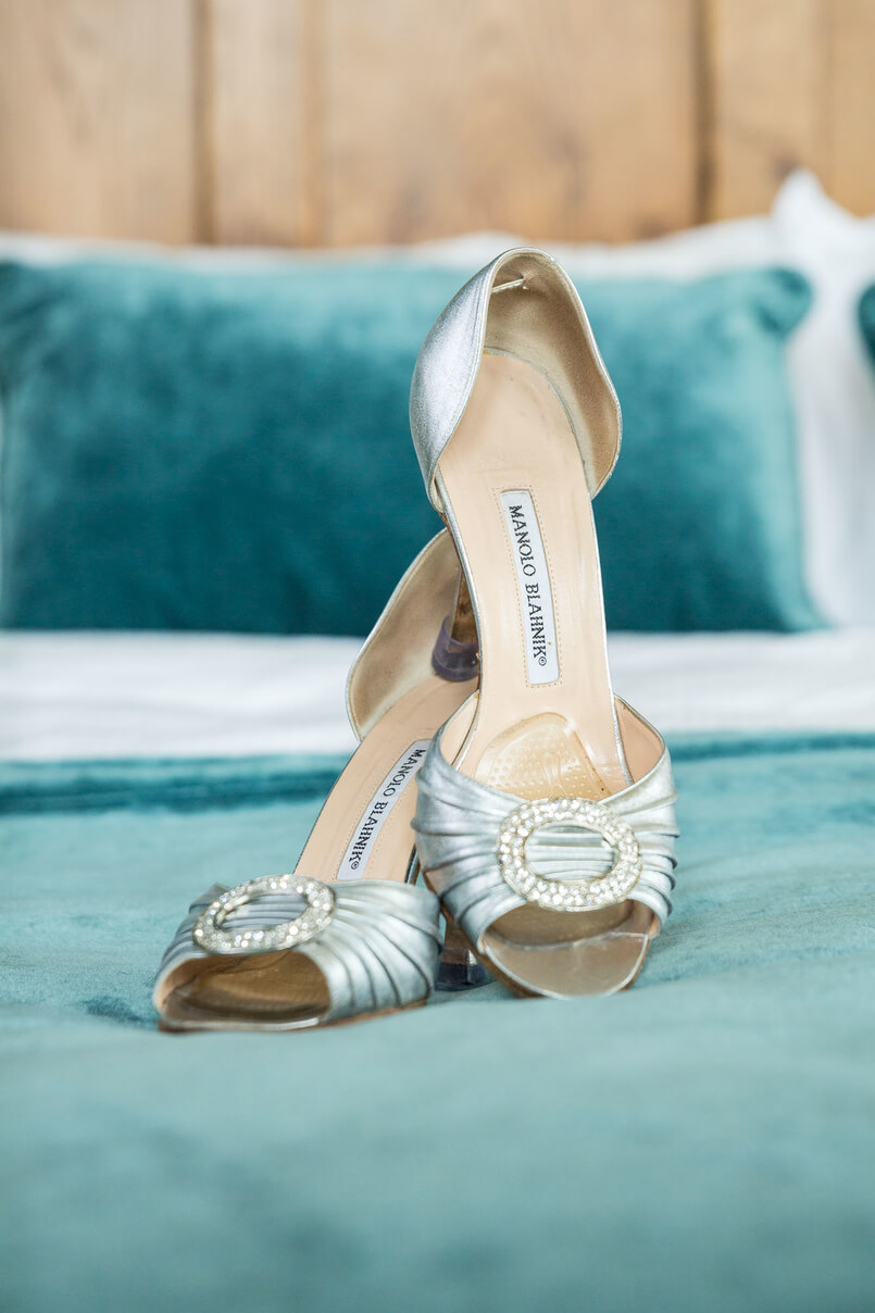 Designer wedding high heeled shoes with silver buckle on the toe