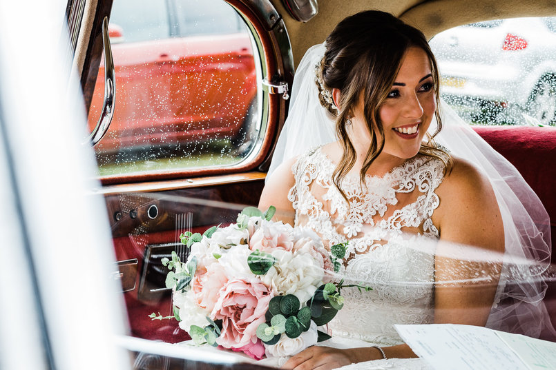 Chilham Bride Yasmin sitting in Big Day Cars' seven-seater limousine, on the way to her wedding