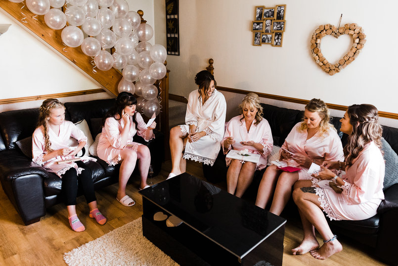 Yasmin with her bridesmaids, mum and flowergirls, getting ready on her wedding morning