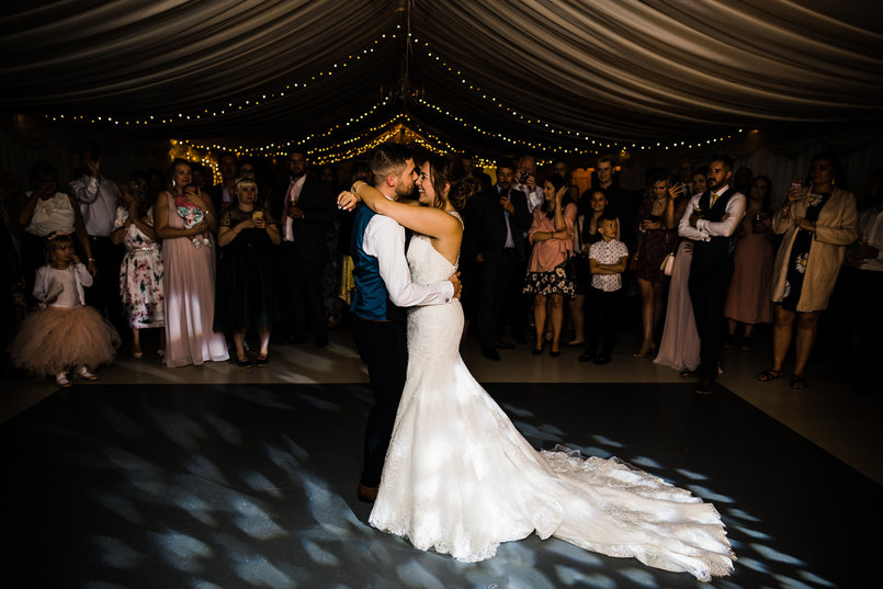 Yasmin and Matt sharing their first dance at their wedding at Reach Court Farm in St Margaret's Bay