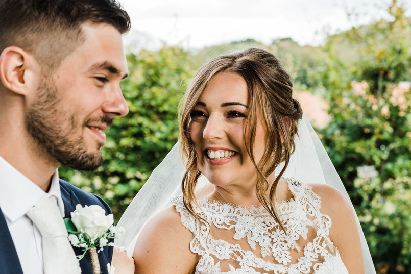 Low, boho-style bun by Willow Tree Hair and Beauty wedding hair and wedding makeup, following a soft glam theme by Kent-based makeup artist Elizabeth Joseph Love